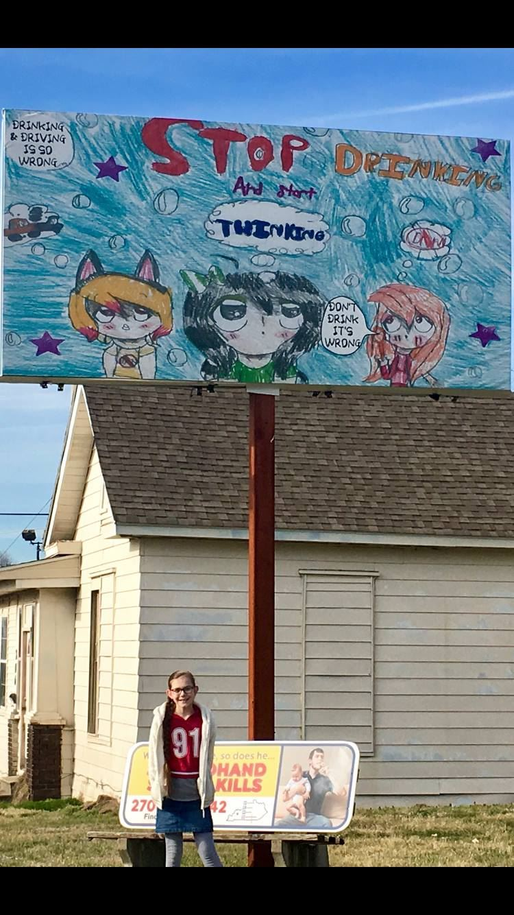 "CONGRATULATIONS to Earlington Elementary 5th grader BRILEY WHITE for winning Earlington's ""Don't Drink & Drive"" Slogan/Drawing Contest. Briley's picture is displayed on the billboard at the corner of South Lee Trover Todd Jr. Highway and Moss Ave."