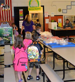 Students pick up breakfast in cafeteria