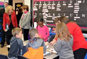 Group of students work together at Earlington Elementary as the Superintendent and other administrators observe