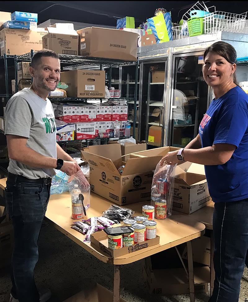 Steve Bauer and Jan Richey volunteer at food bank