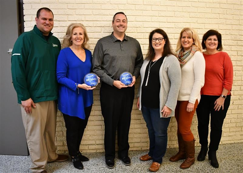 District Officials pose with EF High School Exchange Year Awards.