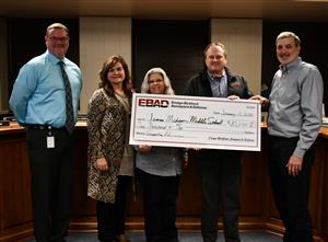 Ensign Bickford presents donation check to James Madison Middle School